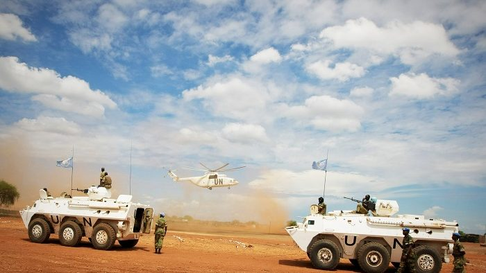 An Mi-26 heavy lift cargo helicopter of the UN Mission in Sudan (UNMIS) is seen landing as UNMIS troops prepare to depart from their mission site in armoured personnel carriers for a patrol around Abyei town.