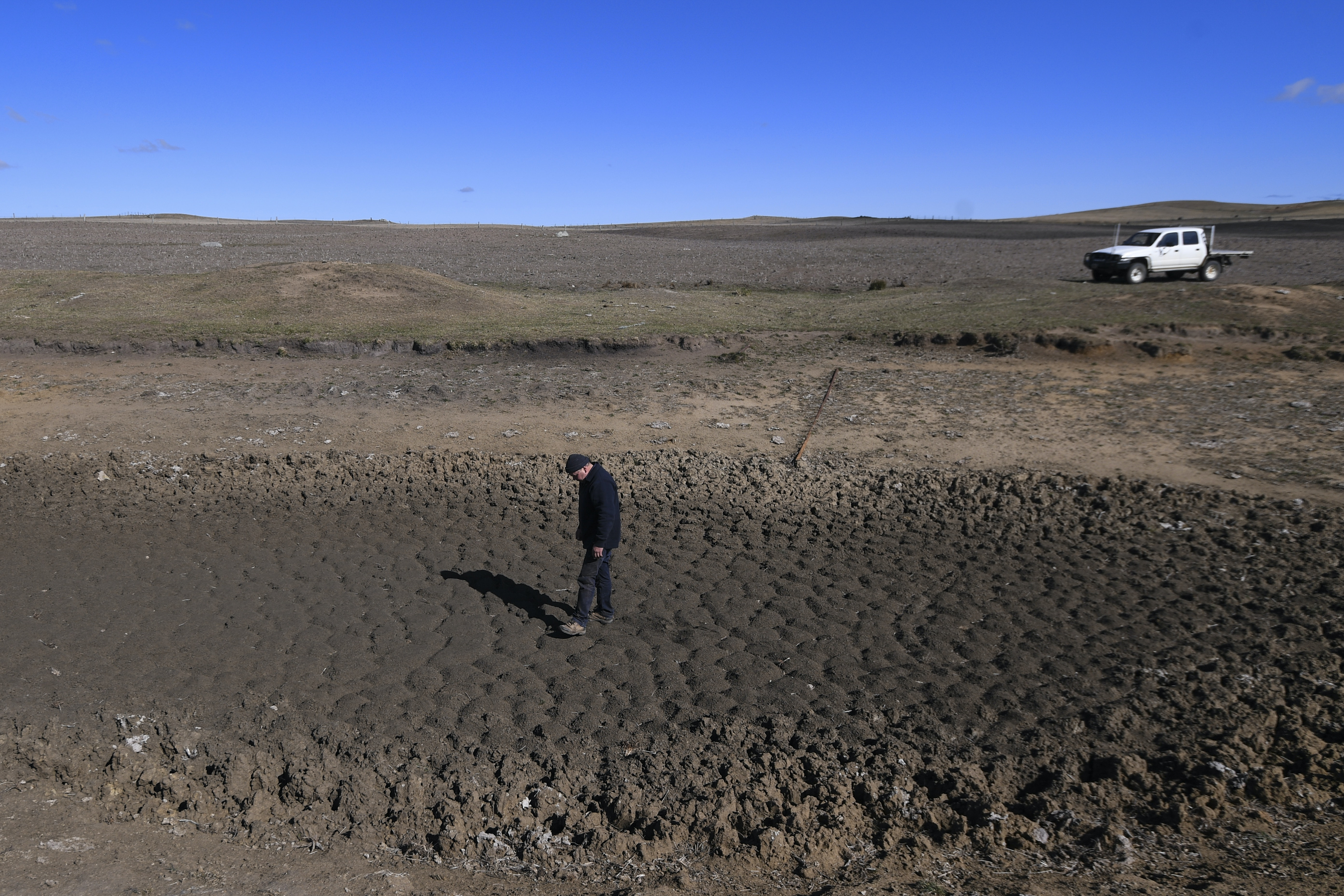 Farmer Ian Cargill stands in a middle of a dam on his property near Braidwood, NSW, in August 2018. At the time 100% of the state was drought-affected.