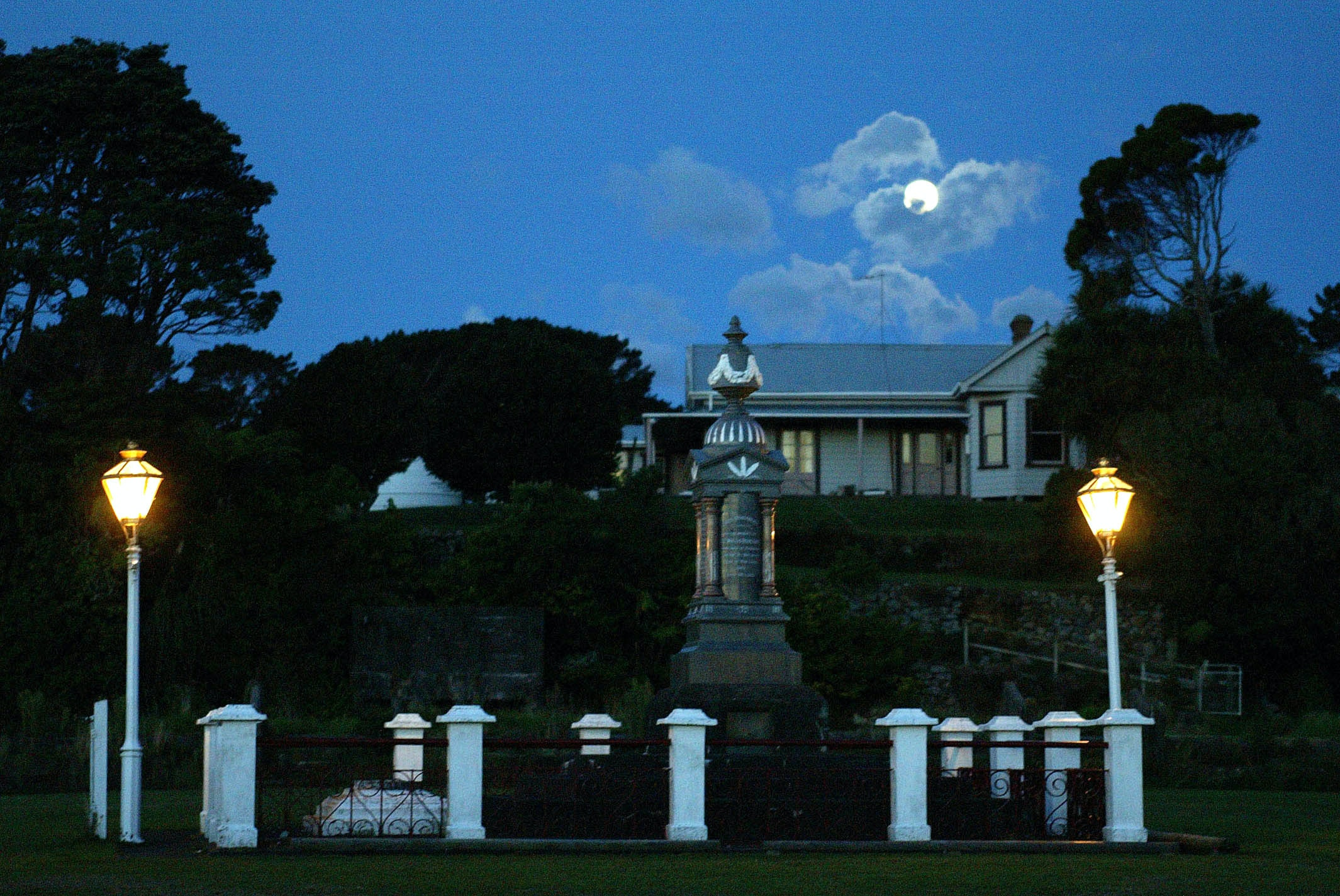 Burial place of Parihaka founder Te Whiti with moon rising above