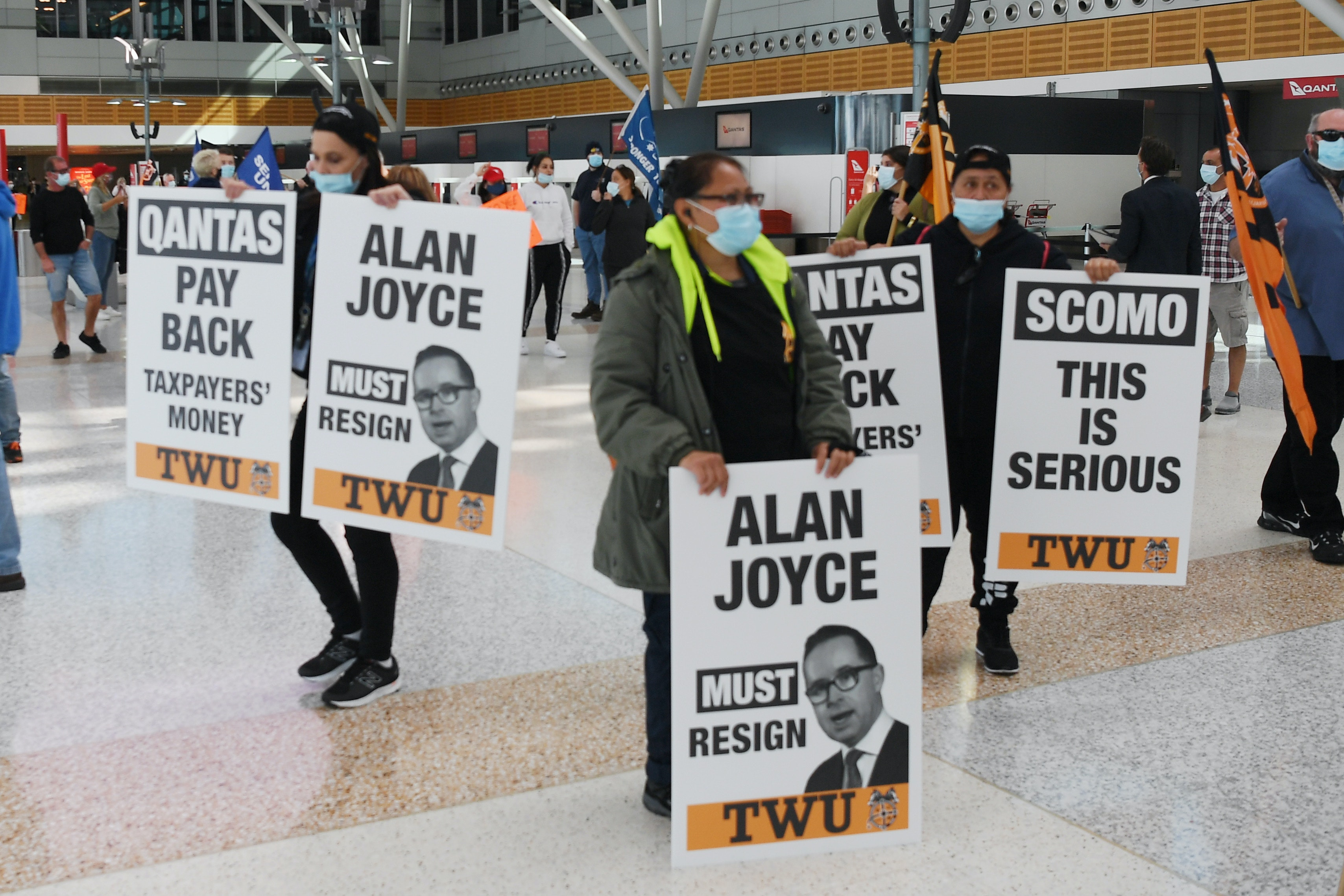 Unionists demonstrate against Qantas' staff cuts at Sydney's domestic terminal on August 27, 2020.